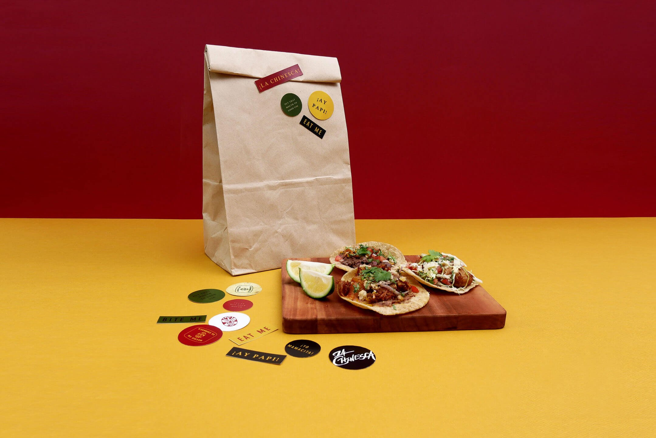 La Chinesca's tacos, stickers, and paper bag packaging